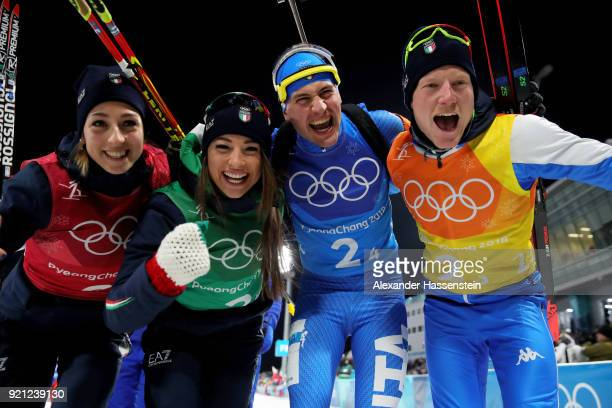 Lisa Vittozzi Dorothea Wierery Dominik Windisch and Lukas Hofer of Italy celebrate after winning the bronze medal during the Biathlon 2x6km Women...