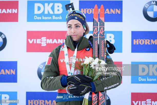 Lisa Vittozzi of Italy celebrates after placing second during the podium ceremony for the IBU Biathlon Women 125 km Mass Start event in Pokljuka on...
