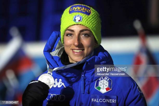 Lisa Vittozzi of Italy celebrates the Silver medal at the Medal Ceremony for the IBU Biathlon World Championships Women 15km at Medal Plaza on March...