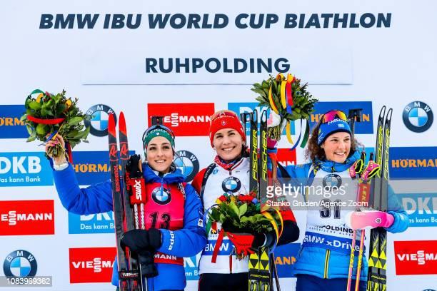 Lisa Vittozzi takes 2nd place, Anastasiya Kuzmina of Slovakia takes 1st place, Hanna Oeberg of Sweden takes 3rd place during the IBU Biathlon World...