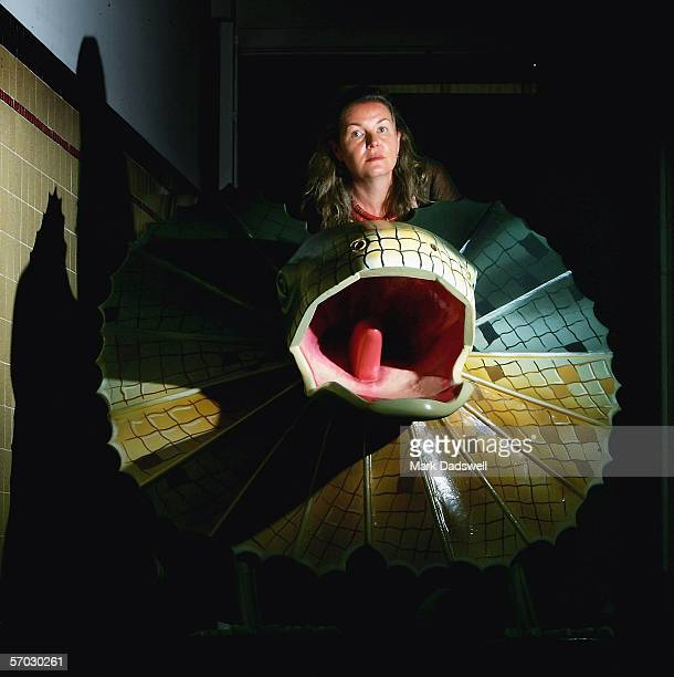 Lisa Warrener Cultural Producer at Exhibitions for Festival Melbourne 2006 studies a Fantasy Coffin in the shape of a frilled neck lizard at 45...