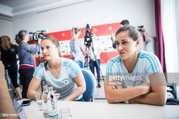 Lisa Weiss and Laura Benkarth talk to the reporter during Germany Women's National Soccer Team Media Day on July 5 2017 in Heidelberg Germany