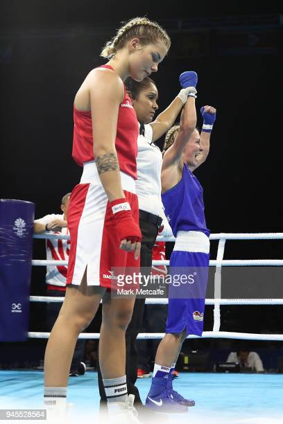 Lisa Whiteside of England celebrates winning her Women's Fly 4851kg Semifinal bout against Taylah Robertson of Australia during Boxing on day nine of...