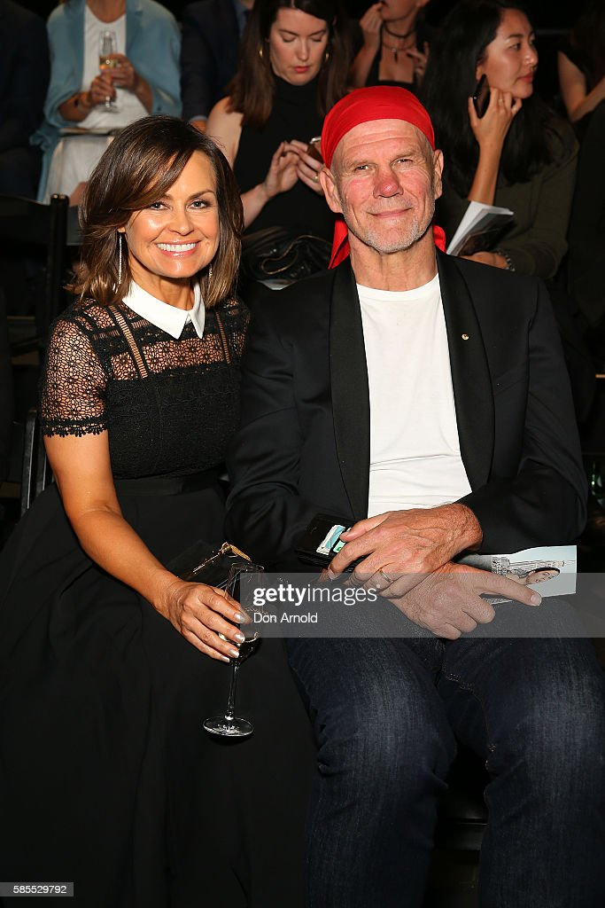 Lisa Wilkinson and Peter FitzSimons sit front row ahead of the runway at the David Jones Spring/Summer 2016 Fashion Launch at Fox Studios on August 3, 2016 in Sydney, Australia.