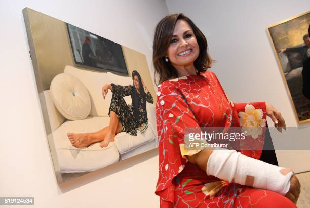 Lisa Wilkinson poses in front of a winning portrait of herself painted by artist Peter Smeeth in the 2017 Archibald Packing Room Prize in Sydney on...