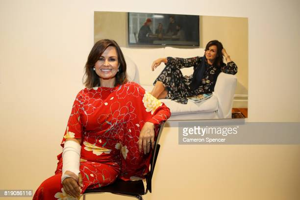 Lisa Wilkinson poses with a portrait of her by artist Peter Smeeth after it was awarded the 2017 Packing Room Prize in this years Archibald Prize at...