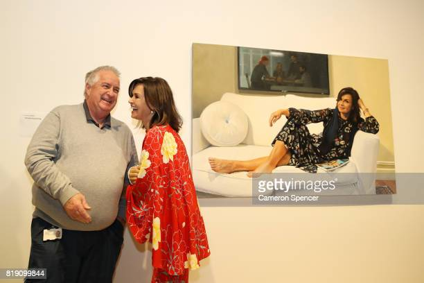 Lisa Wilkinson talks to Art Gallery of New South Wales Head Packer Steve Peters in front of a portrait of her by artist Peter Smeeth after it was...