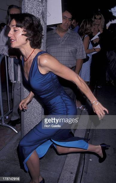 Lisa Zane attends the premiere of Love Stinks on August 11 1999 at Mann Festival Theater in Westwood California