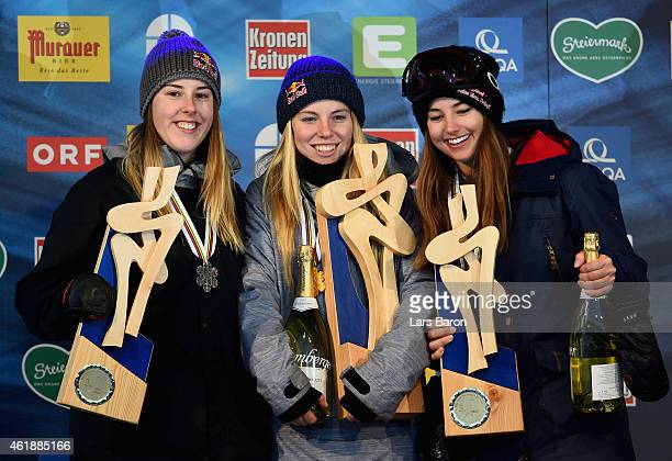 Lisa Zimmermann of Germany celebrates with Katie Summerhayes of Great Britain and Zuzana Stromkova of Slovakia after winning the Women's Freestyle...