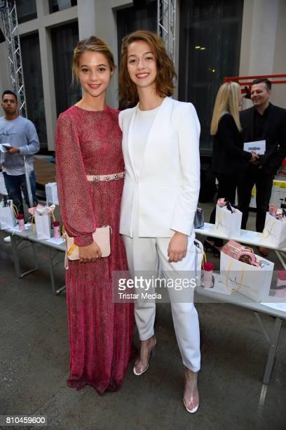 LisaMarie Koroll and her sister LaraSofie Koroll attend the Marina Hoermanseder show during the Berliner Mode Salon Spring/Summer 2018 at...
