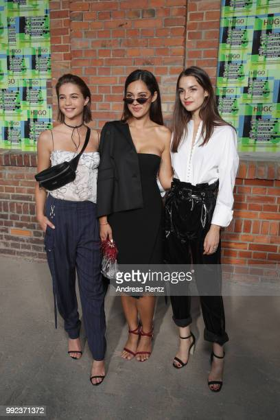 Lisa-Marie Koroll, Nilam Farooq and Luise Befort attend the HUGO show during the Berlin Fashion Week Spring/Summer 2019 at Motorwerk on July 5, 2018...