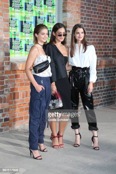 Lisa-Marie Koroll, Nilam Farooq und Luise Befort attend the HUGO show during the Berlin Fashion Week Spring/Summer 2019 at Motorwerk on July 5, 2018...