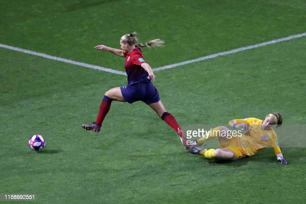LisaMarie Utland of Norway is challenged by Karen Bardsley of England during the 2019 FIFA Women's World Cup France Quarter Final match between...