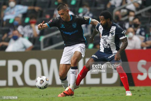 Lisandro Cabrera of Atletico Pantoja fights for the ball with Dorlan Pabon of Monterrey during a second leg match between Monterrey and Atletico...