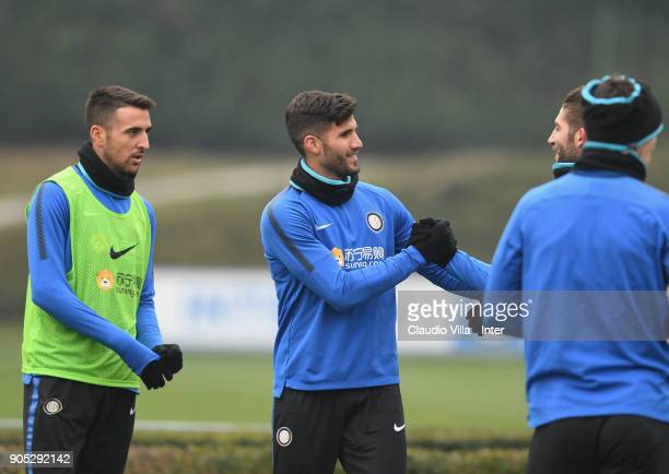 Lisandro Ezequiel López and Roberto Gagliardini of FC Internazionale chat during the FC Internazionale training session at Suning Training Center at...
