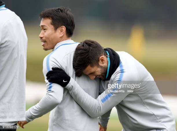 Lisandro Ezequiel López and Yuto Nagatomo of FC Internazionale react during the FC Internazionale training session at Suning Training Center at...