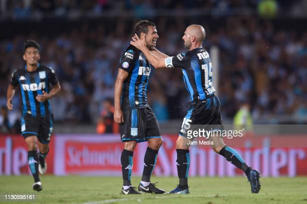 Lisandro Lopez celebrates after scoring the first goal of his team with teammate Dario Cvitanich during a match between Racing Club and Godoy Cruz as...