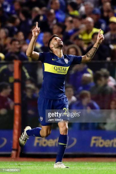 Lisandro Lopez of Boca Juniors celebrates after scoring his side's first goal during a second leg semifinal match between Boca Juniors and Argentinos...