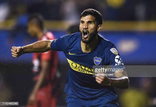 Lisandro Lopez of Boca Juniors celebrates after scoring the equalizer during a group G match between Boca Juniors and Atletico Paranaense as part of...