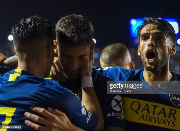 Lisandro Lopez of Boca Juniors celebrates with teammates after scoring the first goal of his team during a second leg semifinal match between Boca...