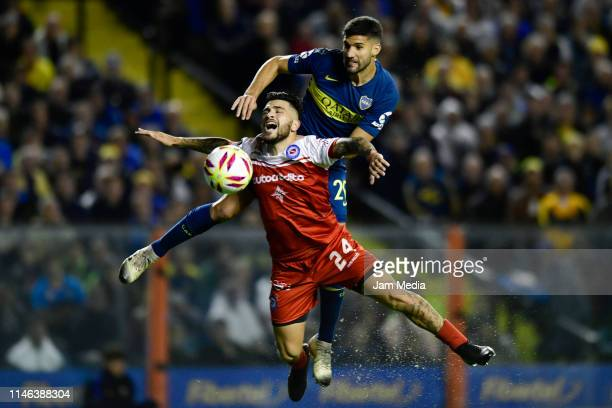 Lisandro Lopez of Boca Juniors heads the ball to score his side's first goal during a second leg semifinal match between Boca Juniors and Argentinos...