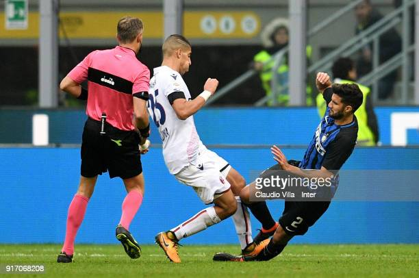 Lisandro Lopez of FC Internazionale and Adam Masina of Bologna FC compete for the ball during the serie A match between FC Internazionale and Bologna...