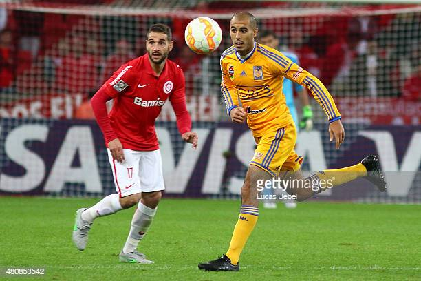Lisandro Lopez of Internacional battles for the ball against Guido Pizarro of Tigres during the match between Internacional v Tigres as part of Copa...