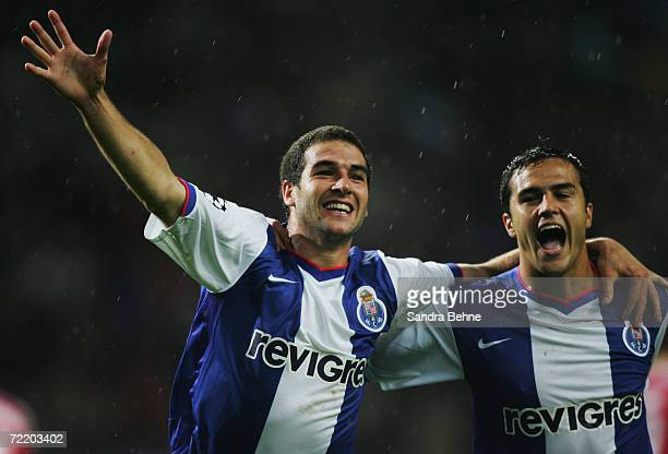 Lisandro Lopez of Porto celebrates with his team mate Bruno Moraes after scoring the fourth goal during the UEFA Champions League group G match...