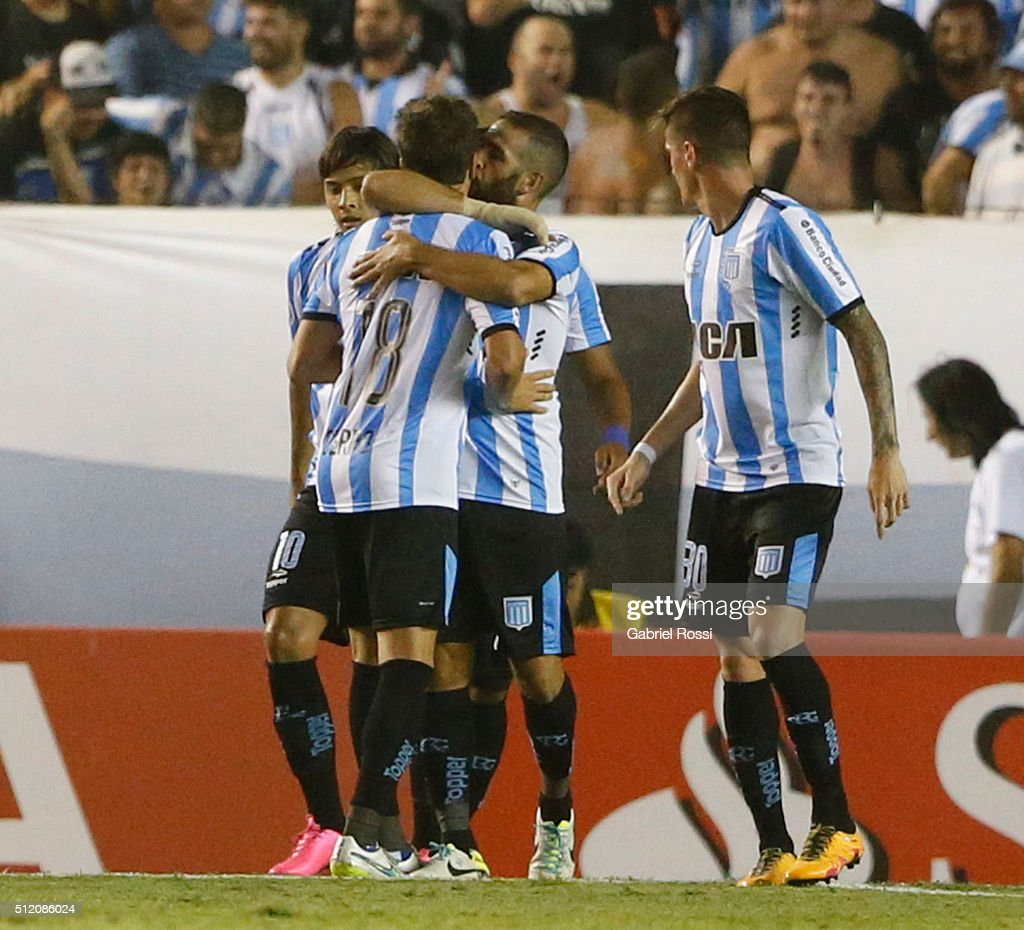Lisandro Lopez of Racing Club and teammates celebrate their team's first goal during a group stage match between Racing Club and Bolivar as part of Copa Bridgestone Libertadores 2016 at Presidente Peron Stadium on February 24, 2016 in Avellaneda, Argentina.