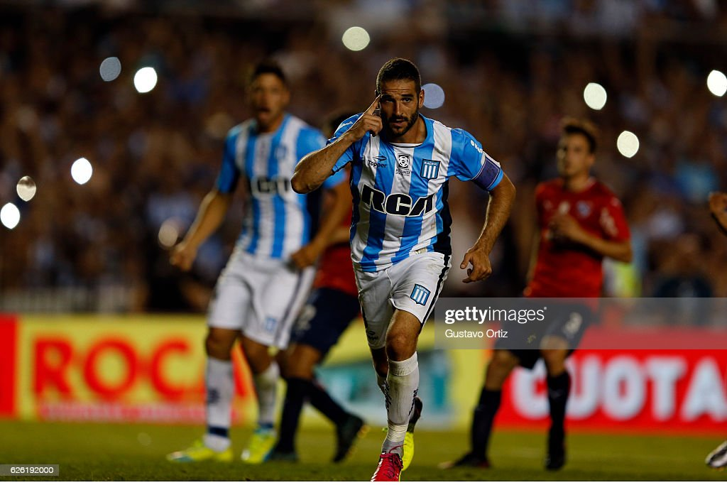 Lisandro Lopez of Racing Club celebrates after scoring the third goal of his team during a match between Racing Club and Independiente as part of Torneo Primera Division 2016/17 at Presidente Peron Stadium on November 27, 2016 in Avellaneda, Argentina.