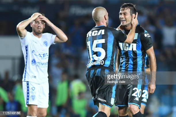 Lisandro Lopez of Racing Club celebrates with teammate Dario Cvitanich after scoring the first goal of his team during a match between Racing Club...