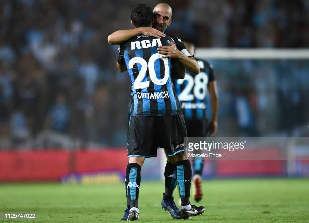 Lisandro Lopez of Racing Club celebrates with teammate Darío Cvitanich after scoring the first goal of his team during a match between Racing Club...
