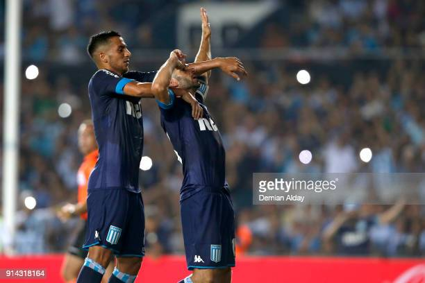 Lisandro Lopez of Racing Club celebrates with teammate Diego Gonzalez after scoring the second goal of his team during a match between Racing Club...