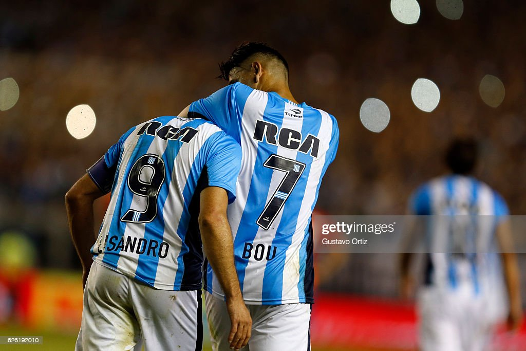 Lisandro Lopez of Racing Club celebrates with teammate Gustavo Bou after scoring the third goal of his team during a match between Racing Club and Independiente as part of Torneo Primera Division 2016/17 at Presidente Peron Stadium on November 27, 2016 in Avellaneda, Argentina.