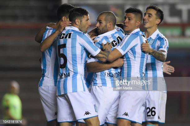 Lisandro Lopez of Racing Club celebrates with teammates after scoring the second goal of his team during a match between Argentinos Juniors and...