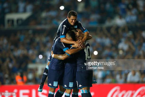 Lisandro Lopez of Racing Club celebrates with teammates after scoring the second goal during a match between Racing Club and Huracan as part of...