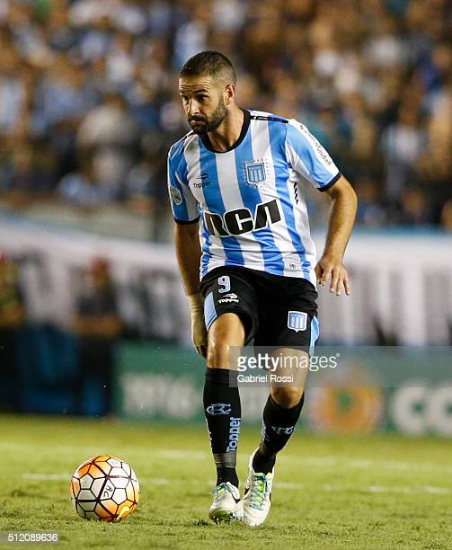 Lisandro Lopez of Racing Club drives the ball during a group stage match between Racing Club and Bolivar as part of Copa Bridgestone Libertadores...