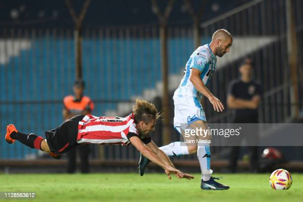 Lisandro Lopez of Racing Club fights for the ball with Facundo Sanchez of Estudiantes during a match between Racing Club and Estudiantes as part of...