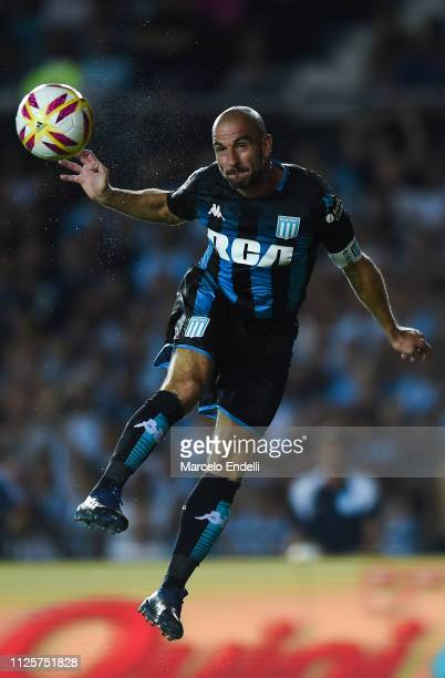 Lisandro Lopez of Racing Club heads the ball during a match between Racing Club and Godoy Cruz at Juan Domingo Peron Stadium on February 18 2019 in...