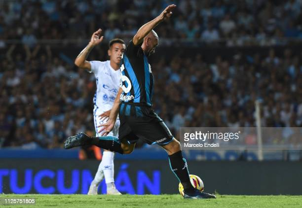 Lisandro Lopez of Racing Club kicks the ball to score the first gola of his team during a match between Racing Club and Godoy Cruz at Juan Domingo...