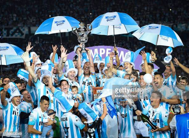 Lisandro Lopez of Racing Club lifts the trophy to celebrate the championship with teammates after a match between Racing Club and Defensa y Justicia...