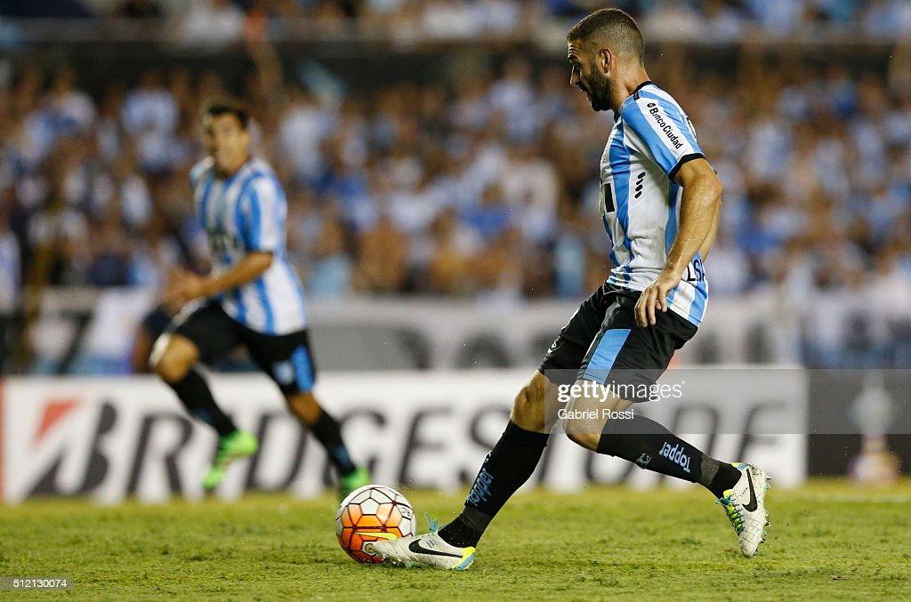 Lisandro Lopez of Racing Club passes the ball to Marcos Acuña of Racing Club to scores the fourth goal of his team during a group stage match between Racing Club and Bolivar as part of Copa Bridgestone Libertadores 2016 at Presidente Peron Stadium on February 24, 2016 in Avellaneda, Argentina.
