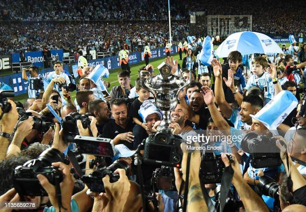 Lisandro Lopez of Racing Club pose with the trophy after winning the Superliga 2018/19 at Presidente Peron Stadium on April 7 2019 in Avellaneda...