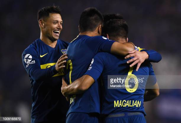 Lisandro Magallan of Boca Juniors celebrates with teammates after scoring the first goal of his team during a match between Boca Juniors and Alvarado...