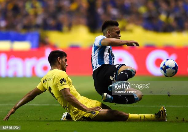 Lisandro Magallan of Boca Juniors fights for ball with Lautaro Martinez of Racing Club during a match between Boca Juniors and Racing Club as part of...