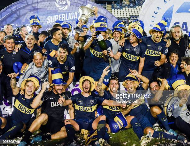 Lisandro Magallan of Boca Juniors lifts the trophy to celebrate with teammates after winning the Superliga 2017/18 against Gimnasia y Esgrima La...