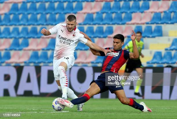 Lisandro Magallan of Crotone competes for the ball with Ante Rebic of Milan during the Serie A match between FC Crotone and AC Milan at Stadio...