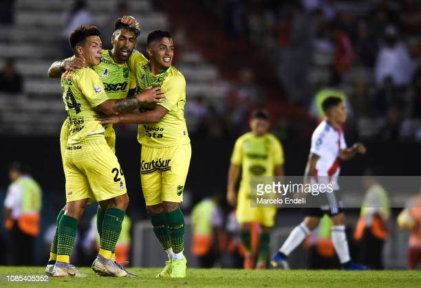 Lisandro Martinez Alexander Barboza and Leonel Miranda of Defensa y Justicia celebrate after winning a match between River Plate and Defensa y...