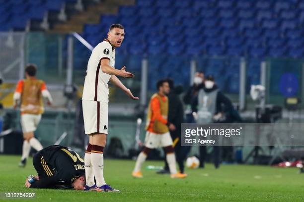 Lisandro Martinez of Ajax and Edin Dzeko of AS Roma during the UEFA Europa League Quarter Final: Leg Two match between AS Roma and Ajax at Stadio...