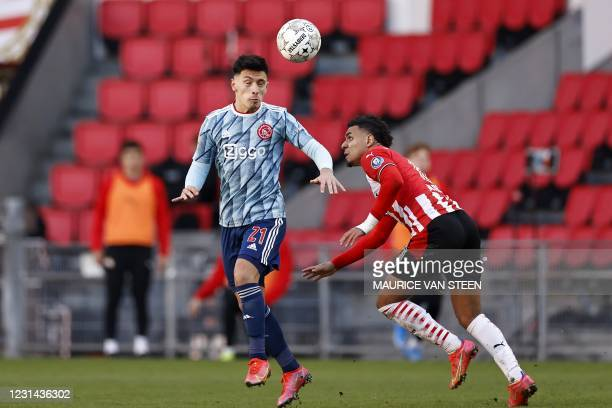 Lisandro Martinez of Ajax fights for the ball with Donyell Malen of PSV Eindhoven during the Dutch Eredivisie match between PSV Eindhoven and Ajax...